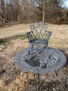 54-in cast aluminum patio table and one cast aluminum patio chair