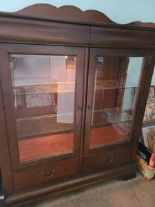 Broyhill illuminated cabinet with beveled glass doors. 58x51x17 inches, two drawers above and two drawers below.