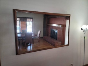 Large *HEAVY* wood trim hanging mirror.