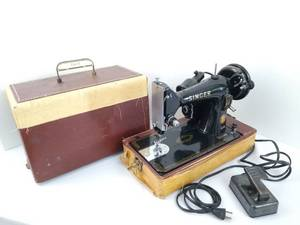 Portable Singer sewing machine in a lock box