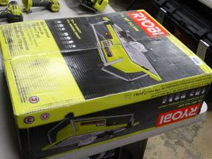 "Ryobi 7"" wet tile saw in box"