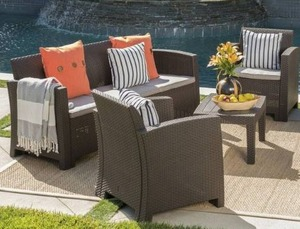 Jacksonville Outdoor 4-piece Wicker-style Chair Set with Sofa and Cushion by Christopher Knight Home - Retail:$899.49