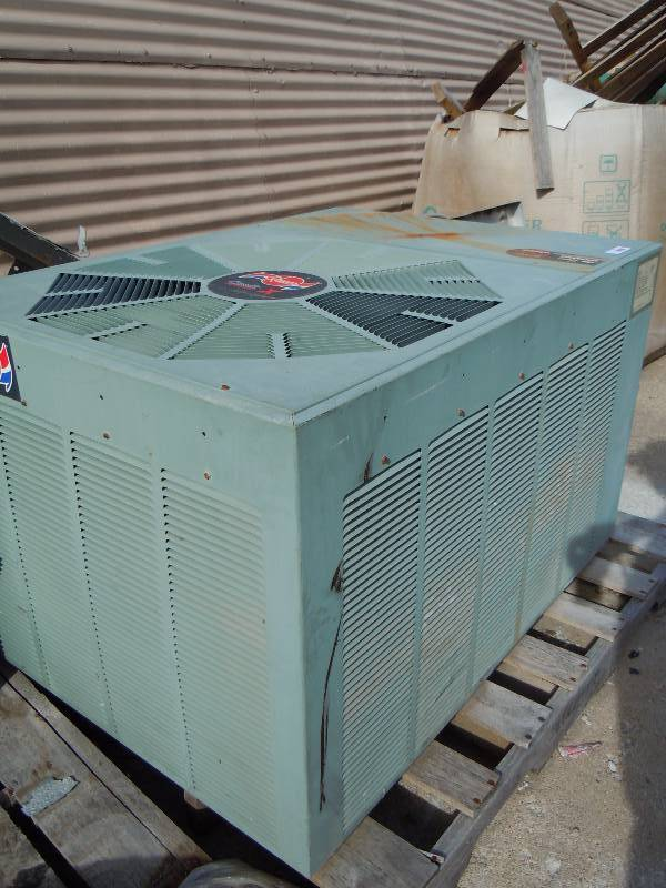 Rheem Classic X Central Air Conditioner Unit Under The