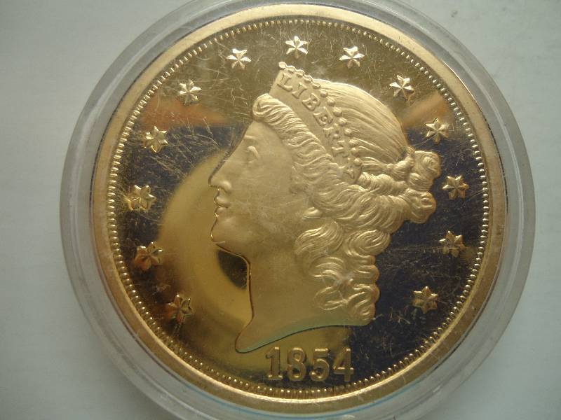 What is an 1854 liberty gold dollar worth? - Answers.com