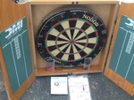 Pro Dart board with cabinet comes with new darts great for rec room or man cave