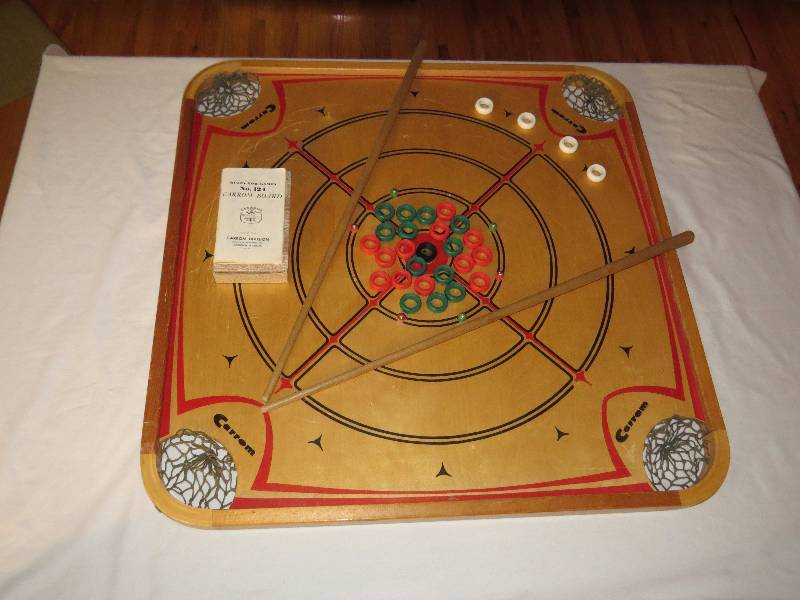 Vintage carrom board with shooting sticks and game pieces express vintage carrom board with shooting sticks and game pieces express yourself olathe asset liquidation equip bid solutioingenieria Gallery