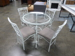 METAL DINING TABLE WITH GLASS TOP AND FOUR CHAIRS - HAS RUST IN SPOTS
