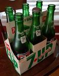 6 pack of real glass 7UP bottles and cardboard carrier