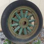 Your guess is as good as mine.  Old wood front tire and wheel with the brake drum still bolted to it.