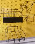 A group of 3 different wire literature display racks for peg board mounting.