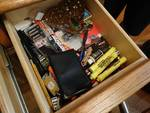 Contents of drawers in china cabinet- Batteries, hardware, office items.