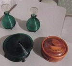 Dresser set - three pieces in green glass and one wooden power dish