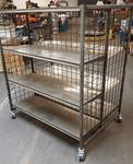 Retail display rack on swivel casters with adjustable shelves and double sided.  51