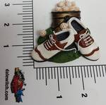 New 3 dimensional plastic fridge magnet of a golfers shoes, balls and bag.