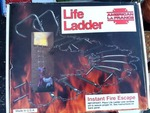 Still in box life latter second-story fire ladder