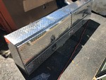 Very nice high dollar truck toolbox diamond plate large upper compartment smaller lawn compartment retails for $900