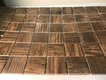 "Case of 12 sheets of beautiful tile 12"" x 24"" x 1/4"" thick and the squares are 2 inch it is wood grain looking the color is called Pecan"