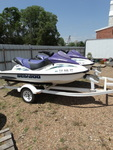 "2 2002 Sea-doo jet skis, runs good. trailer included and has 2"" ball."