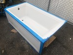 New American standard fiberglass bathtub deep soaker style as pictured has small shipping Chip on the bottom corner does not affect tub easy cover up