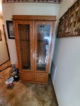 Lighted gun cabinet with glass front