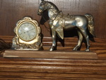 United shelf starting clock with horse metal.