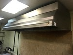 Nice 10 foot stainless steel exhaust hood with the fan on the roof and Ansell system total package