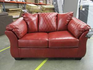 REALLY SWEET RED LOVESEAT....has a slit on one side and a few scuffs from shipping damage