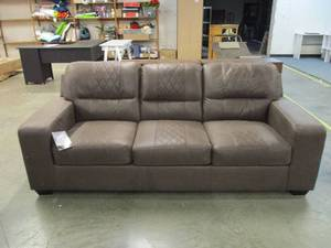 Brown Sofa....has shipping damage on one side along the bottom and on one edge