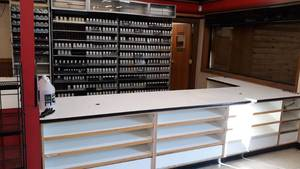 Lot of Check out counter, racks, and desk