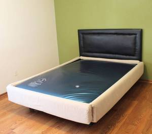 Queen Size Waterbed with Black Headboard and Natural/Ivory Upholstered Side Boards - Could Convert to a Platform Bed with Q Mattress!
