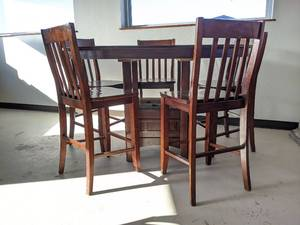 Oval Wooden Dining Table And Five Chairs