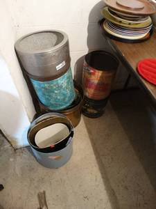 lot of large metal cans