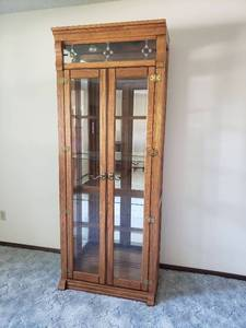Curio with Beveled Glass Front Doors and Glass Shelves