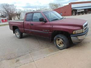 2003 Dodge Truck - Runs & Drives- New Tires - 155K Miles 4 wheel drive does not engage - Needs Brakes - Check Engine Light is on - Engine seems to be missing