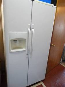 Frigidaire side x side refrigerator w/ ice & water in door- Works as should