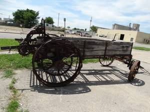 Wooden rusty agricultural manure spreader.