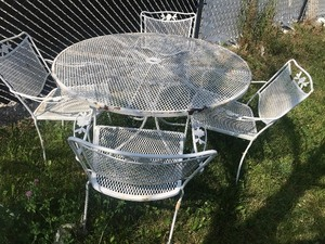 Iron set of patio furniture table and four chairs as pictures