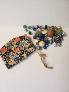 Pouch with marbles