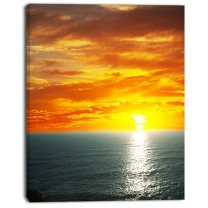 Designart 'Fantastic Sunset over Sea Waters' Large Seashore Canvas Print