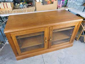 Wooden entertainment center with 2 glass doors and 3 shelves per side 30 1/2 in H X 54 in W X 24 in D